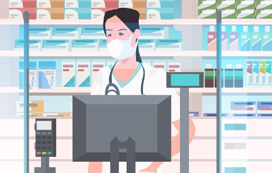 Pharmacist at counter wearing facial mask