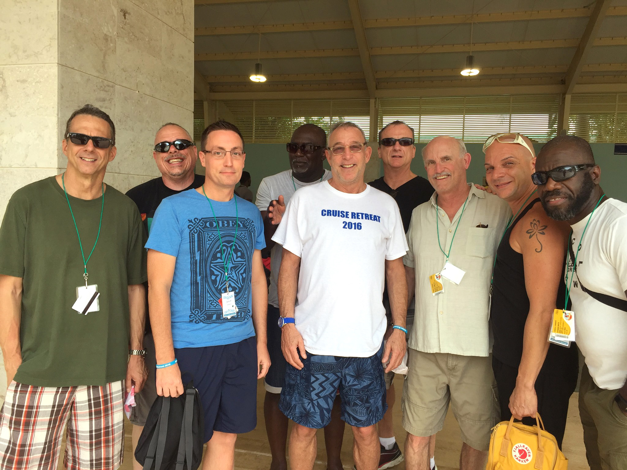 "Paul Stalbaum appears in the center, wearing a white t-shirt that reads ""Cruise Retreat 2016"""
