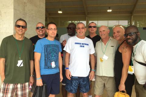"""Paul Stalbaum appears in the center, wearing a white t-shirt that reads """"Cruise Retreat 2016"""""""